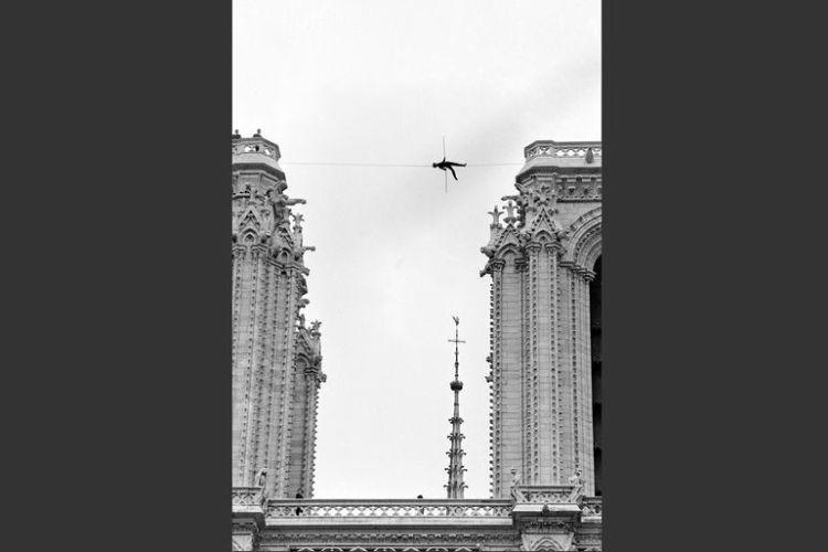 Philippe Petit walks between the steeples of Notre Dame in Paris, June 1971.
